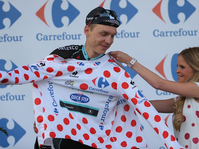 Tony Martin receives the polka dot jersey