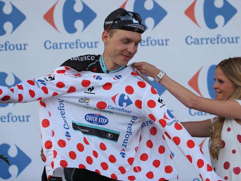 Tony Martin receives the polka dot jersey