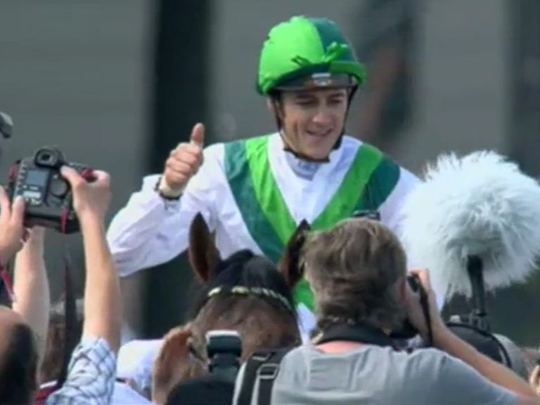 Christophe Soumillon celebrates Sea The Moon's emphatic victory