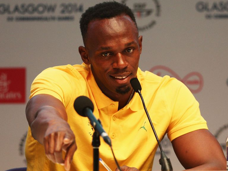 Usain Bolt fields questions from the media after arriving in Glasgow
