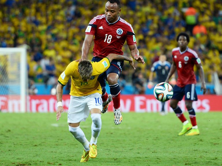 Neymar goes down after being challenged by Juan Zuniga
