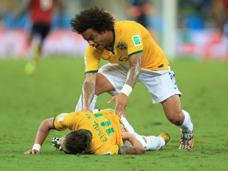 Marcelo checks on Neymar after suffering a serious back injury