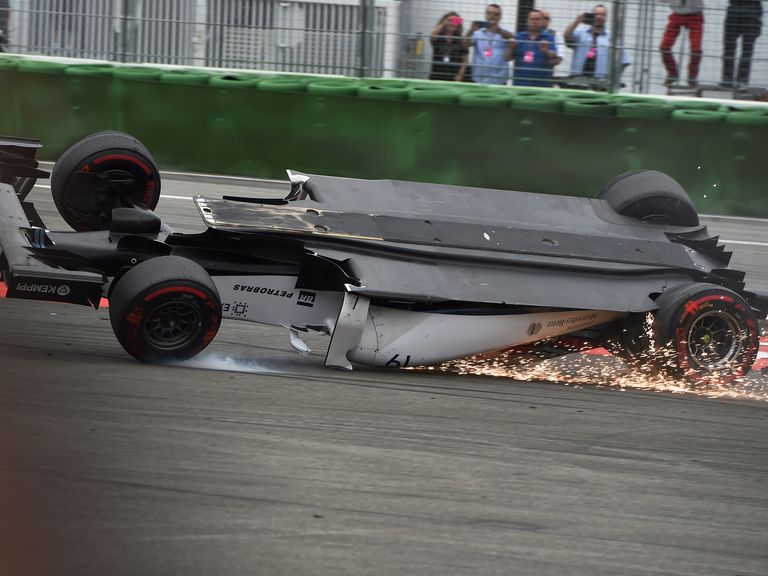 Felipe Massa crashes and rolls at the start of the German Grand Prix