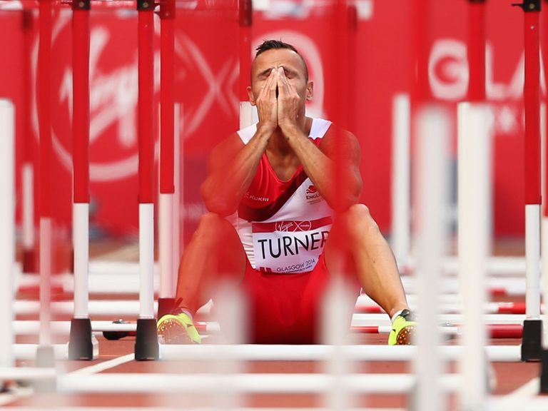 Andy Turner of England sits on the track after failing to finish