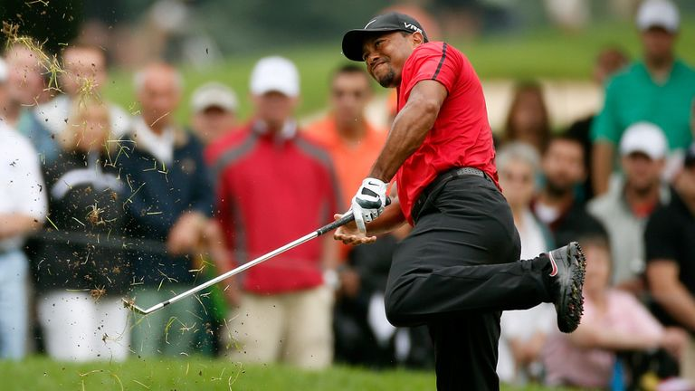 Tiger Woods could miss the USPGA with a recurrence of his back injury