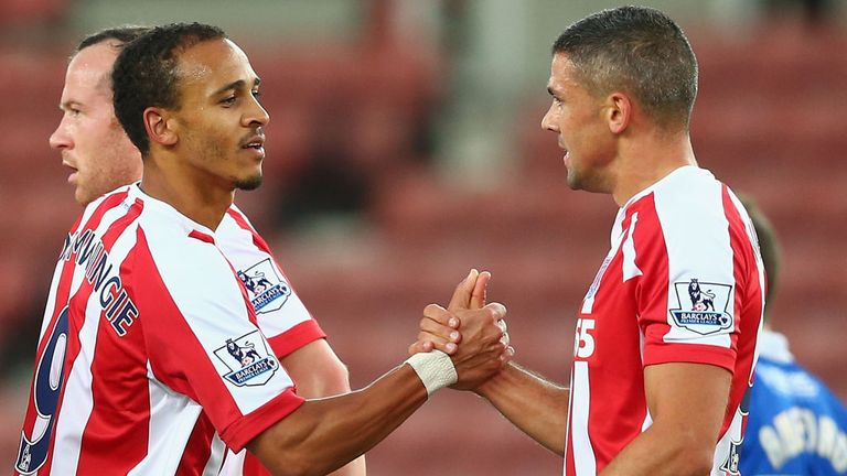 Jonathan Walters: Congratulated by Stoke team-mate Peter Odemwingie