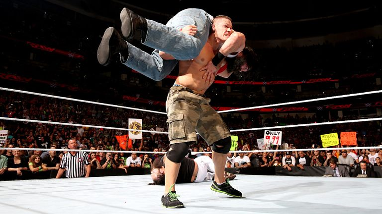 John Cena prepares to give Luke Harper an Attitude Adjustment