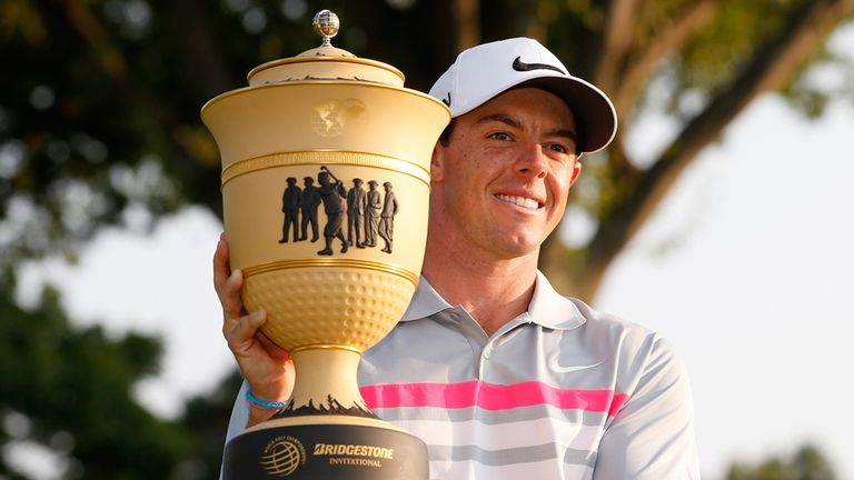Rory McIlroy shows off WGC Bridgestone Invitational trophy after his victory at Firestone.