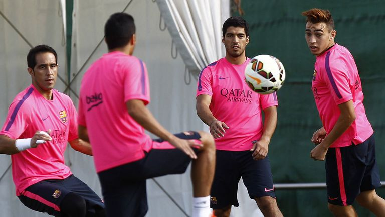Barcelona striker Luis Suarez trained with his new team-mates for the first time.