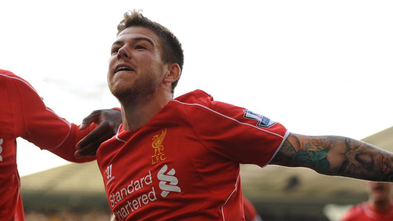 Alberto Moreno: Liverpool defender celebrates his goal against Tottenham
