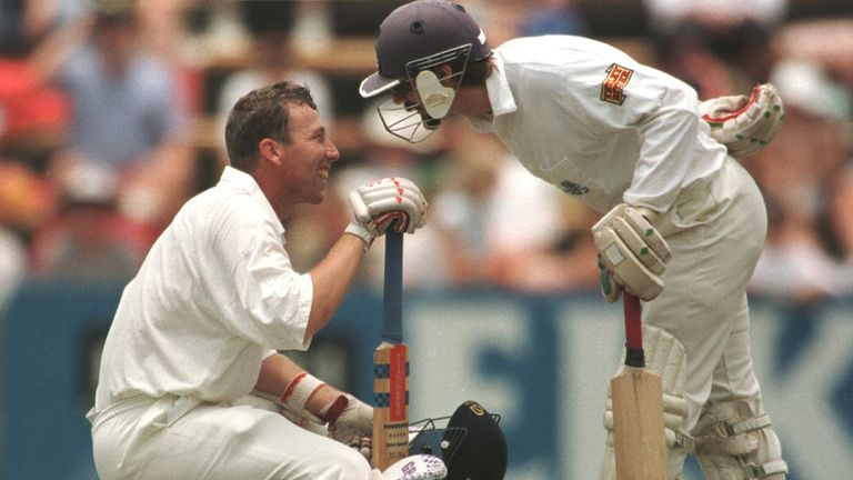 Atherton shares a lighter moment with Jack Russell