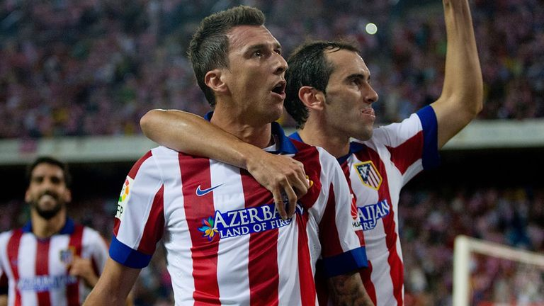 Mario Mandzukic (left) celebrates after scoring for Atletico