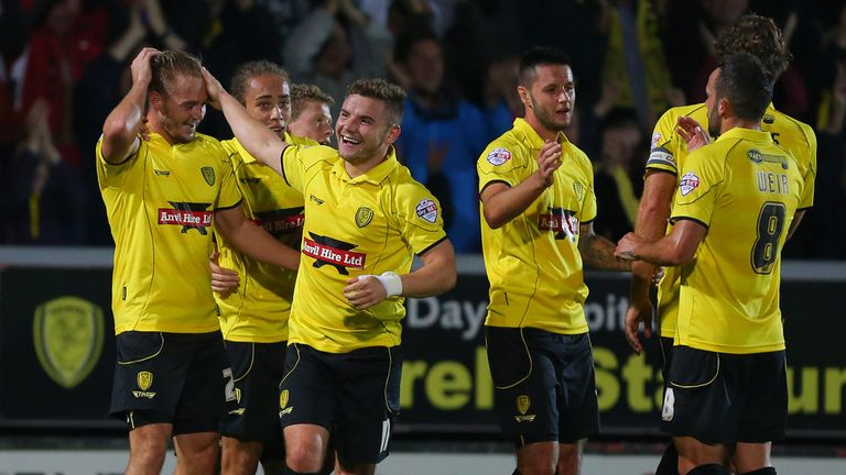 Burton Albion' s Adam McGurk (left) celebrates scoring the winner