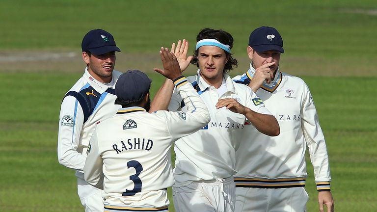 Jack Brooks: Celebrates one of his three wickets on day one at Old Trafford
