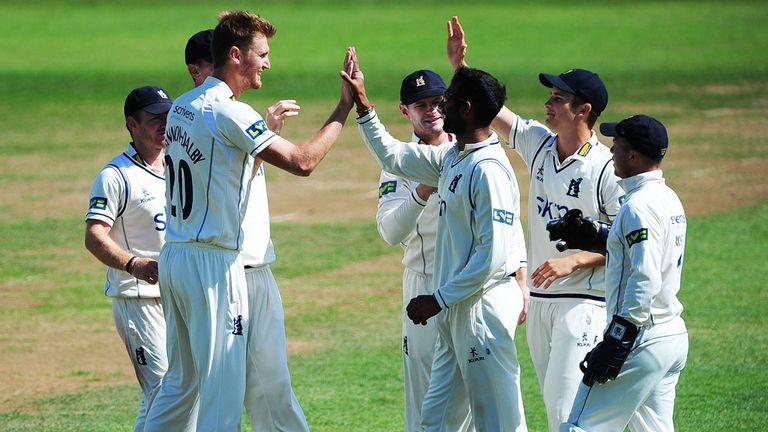Oliver Hannon-Dalby is congratulated on taking a wicket
