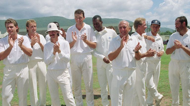 England, including Nasser (second right), reflect on their victory