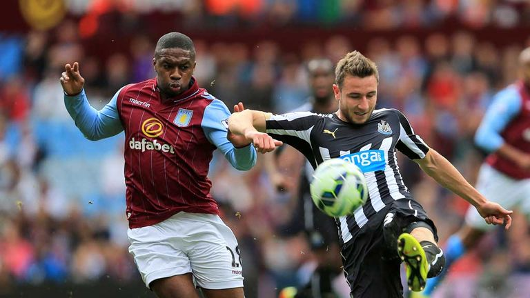 Aston Villa's Charles N'Zogbia (left) and Newcastle United's Paul Dummett battle for the ball during the Barclays Premier League match at Villa Park, Birmi
