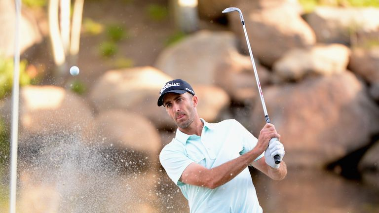 Geoff Ogilvy: hits out of a bunker on the 18th hole, setting him up for a late birdie