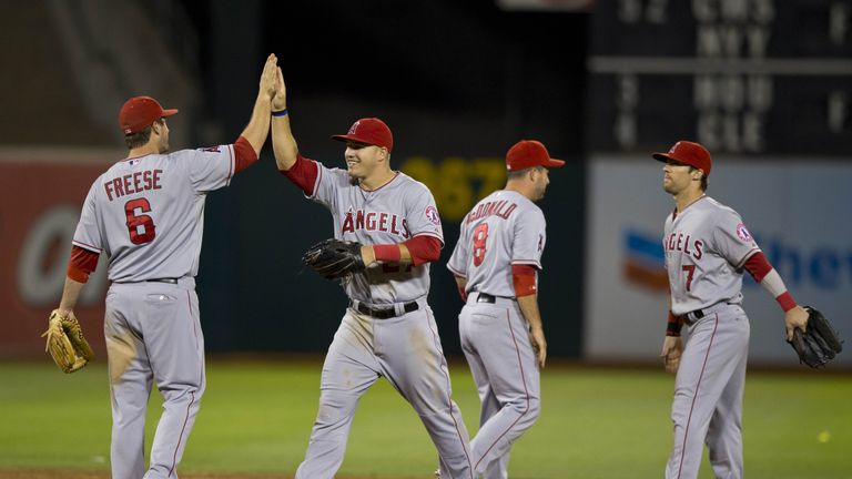 The Los Angeles Angels celebrate beating the Oakland Athletics