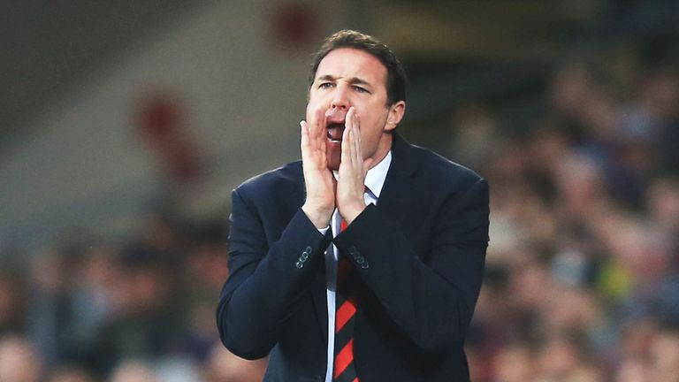 Malky Mackay has apologised for sending three 'inapproriate' messages