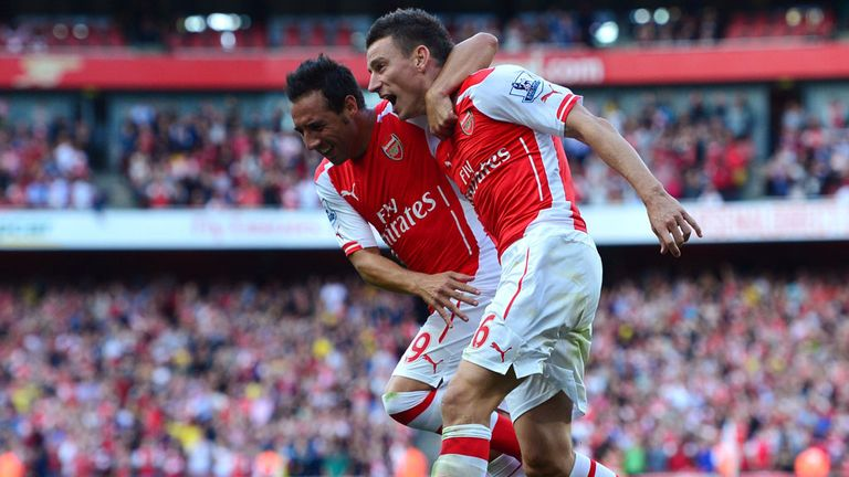 Arsenal's Laurent Koscielny celebrates with Santi Cazorla after scoring the equalising goal