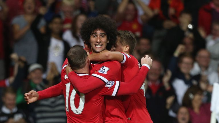 Marouane Fellaini celebrates late winner