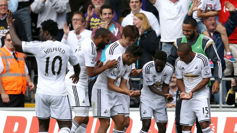 Dyer: 'New dad' celebration with Swansea team-mates