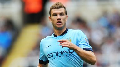 Edin Dzeko: Determined to overcome title rivals Arsenal