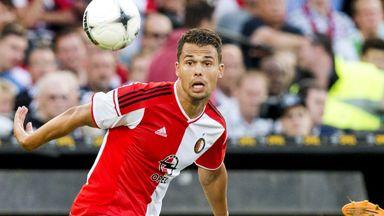 Feyenoord Rotterdam player Mitchell Te Vrede (L) vies for the ball with Besiktas player Necip Uysal