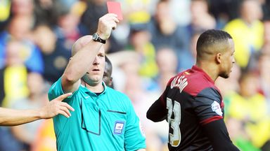 Referee Simon Hooper dismisses Norwich defender Martin Olsson at Molineux