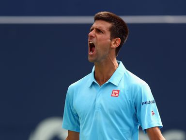 Novak Djokovic celebrates after winning a match at the Rogers Cup