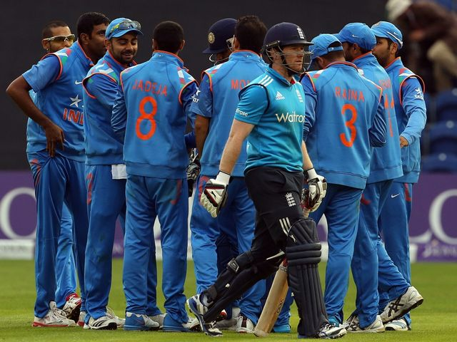 India celebrate as Eoin Morgan trudges off