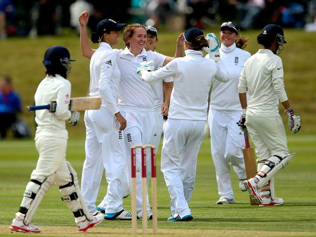 Kate Cross and England celebrate a wicket at Wormsley