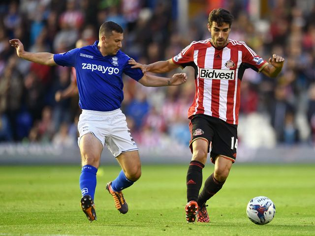 Paul Caddis and Jordi Gomez battle for the ball