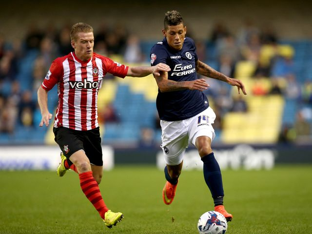 Matthew Briggs of Millwall battles with Steven Davis of Southampton