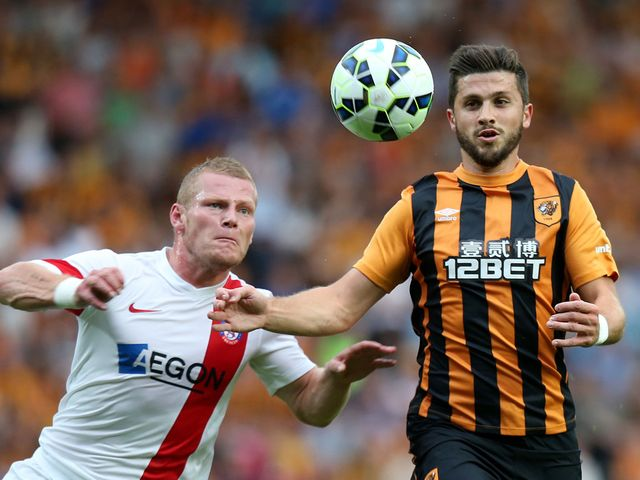 Shane Long (r) battles for the ball