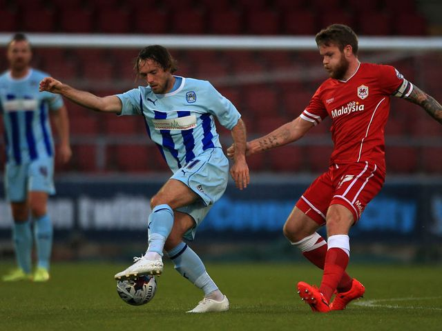 Coventry City's Jim O'Brien holds off challenge from Cardiff City's Aron Gunnarsson