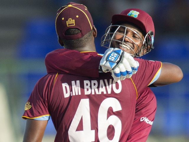 Bravo celebrates his century with Ramdin: The pair put on 258 together