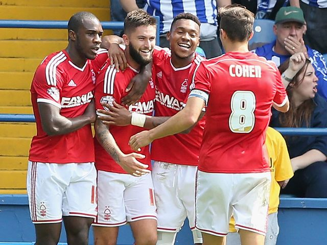 Henri Lansbury celebrates with team mates