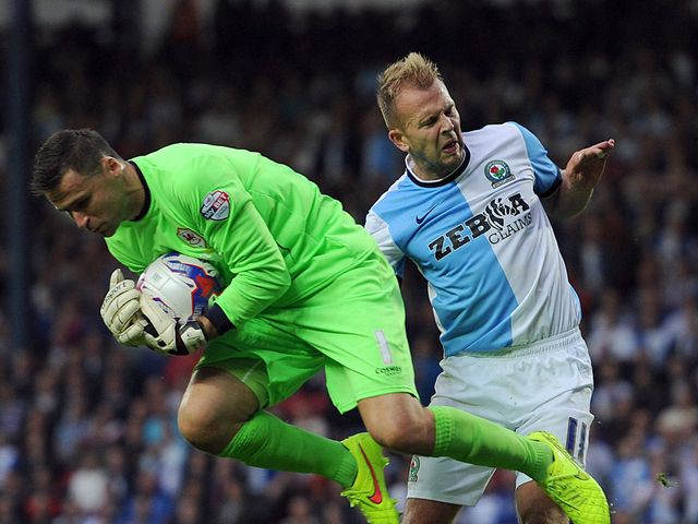 David Marshall gets to the ball before Jordan Rhodes