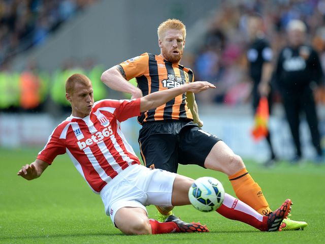 Paul McShane battles for the ball with Steve Sidwell