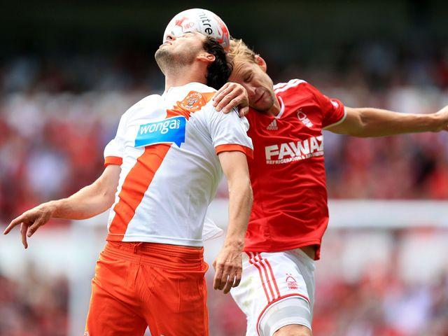 Blackpool's Sergei Zenjov and Daniel Harding battle for the ball