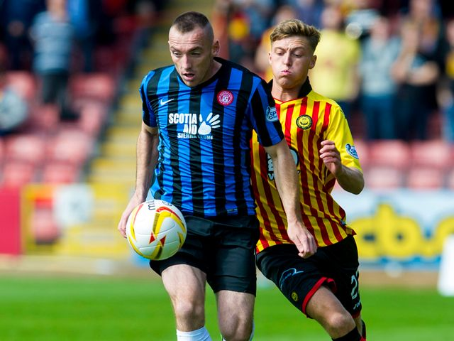 Darian MacKinnon is put under pressure by Gary Fraser