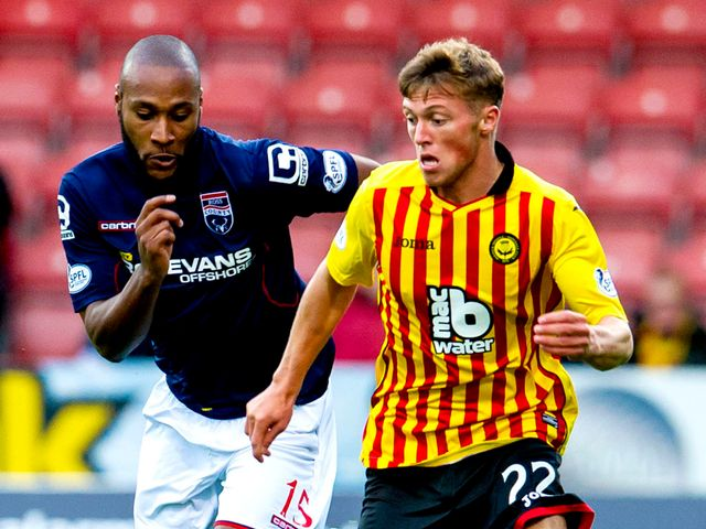 Ross County's Yoann Arquin chases down Partick's Gary Fraser