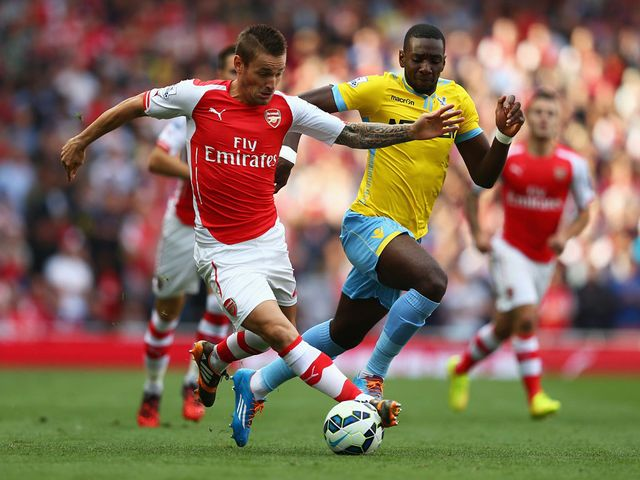 Mathieu Debuchy of Arsenal and Yannick Bolasie of Crystal Palace battle for the ball