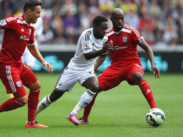 Swansea player Nathan Dyer races through the West Brom defence
