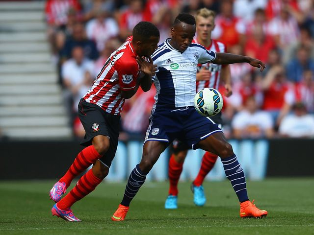 Saido Berahino holds off a challenge from Ryan Bertrand
