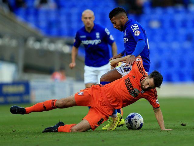 Birmingham City's David Davis challenges Ipswich Town's Cole Skuse