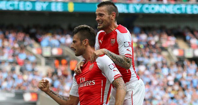 Arsenal's Olivier Giroud (left): Celebrates scoring their third goal of the game with Mathieu Debuchy during the Community Shield match