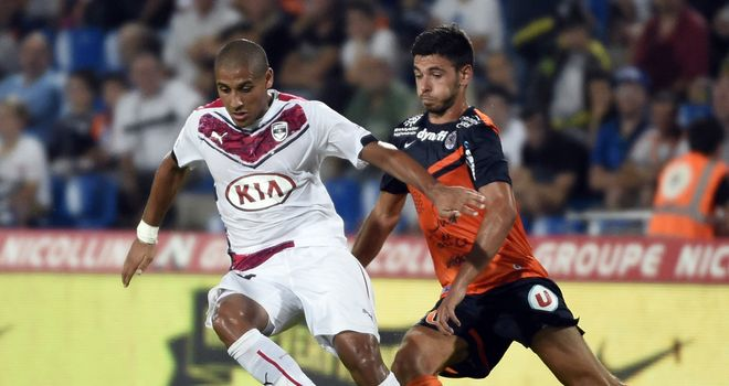Bordeaux's Malian midfielder Wahbi Khazri vies with Morgan Sanson